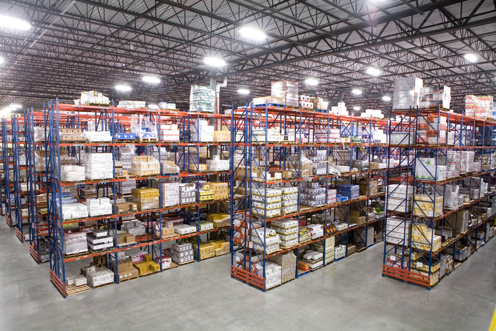 Multiple rows of Frazier's Sentinel Selective Pallet Racking stores product.