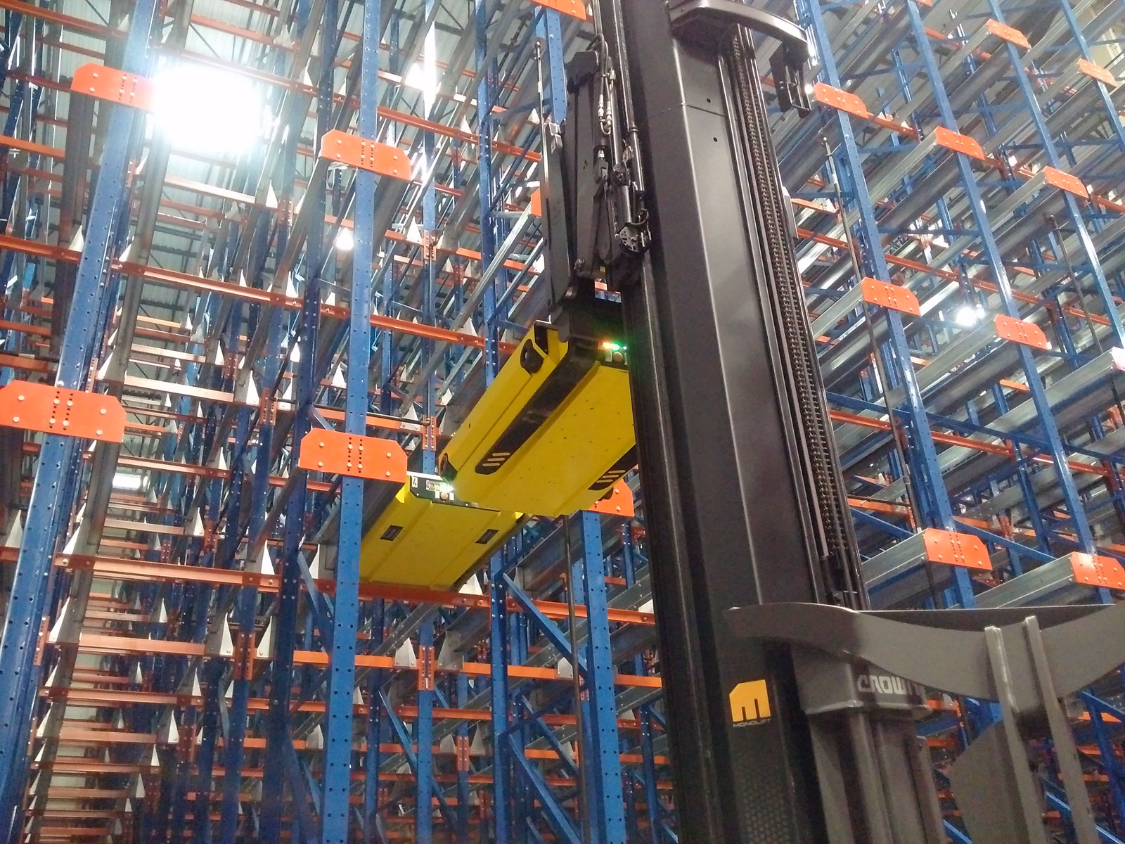 Frazier's Pallet Mole® shuttle is lifted into place by a fork truck.