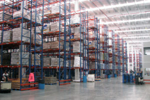 Multiple rows of Frazier's Sentinel® Selective Pallet Rack stores pallets of products.