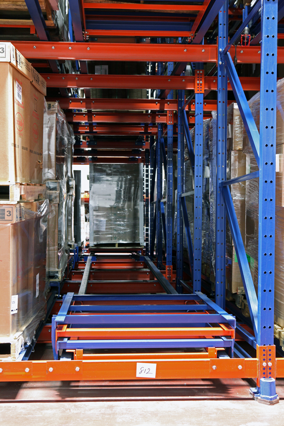 Unloaded Glide-In® Push Back rack carts envelope at the face position.