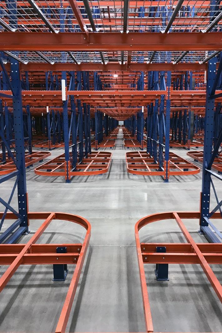 View of aisle to aisle walkthrough access via Ergo Deep® pallet rack.