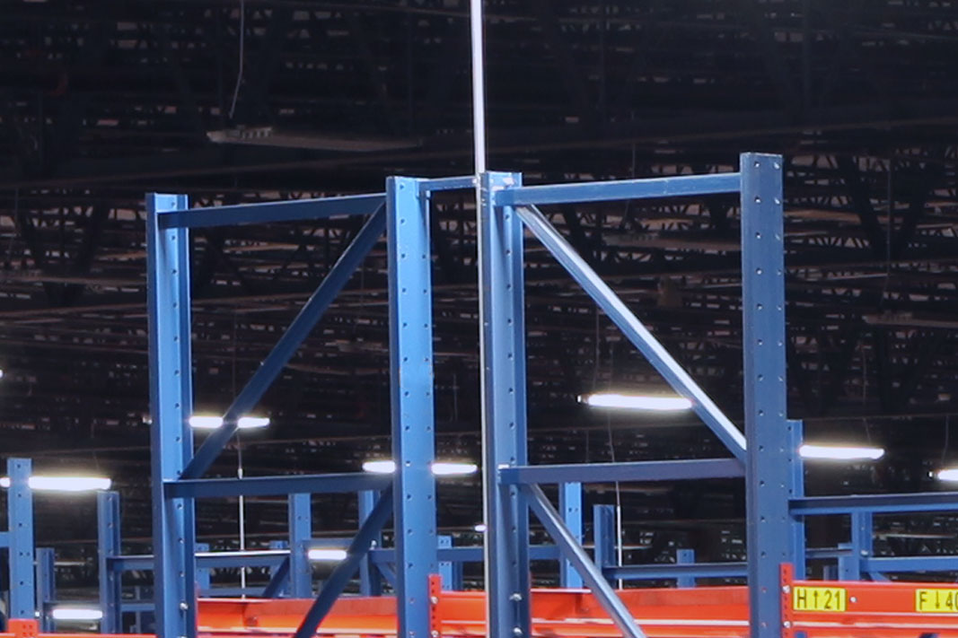 A Back-to-Back Tie connects two pallet rack frames.