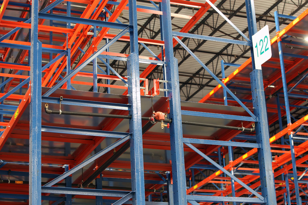 Pallet rack frames with boxed columns.